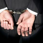 Blog- Handcuffs and Suit